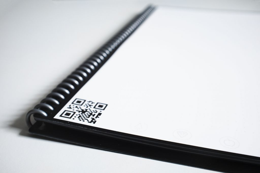 Canva – Black Spiral Notebook With Bar Code on Table